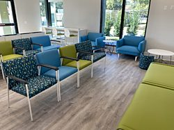 Brightly colored chairs and benches in a waiting room setting